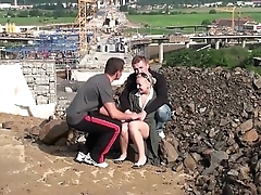 Young cute blonde teen cooky PUBLIC threesome at a construction site