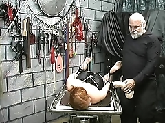 red head slave is bound to table plus fucked by dildo