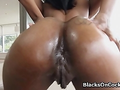 Pounding oiled black booty from behind